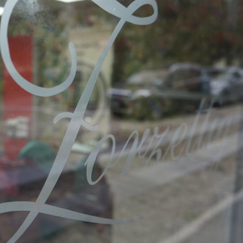 vetrofania logo argento
